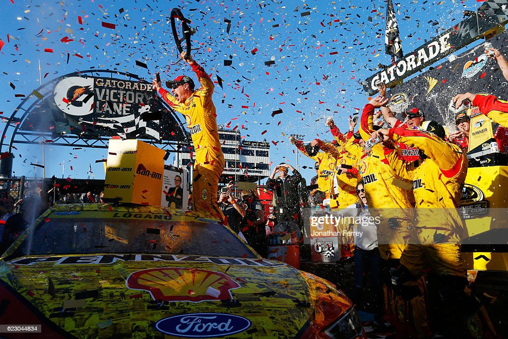 Joey Logano, driver of the #22 Shell Pennzoil Ford, celebrates in Victory Lane after winning the NASCAR Sprint Cup Series Can-Am 500 at Phoenix International Raceway on November 13, 2016 in Avondale, Arizona.