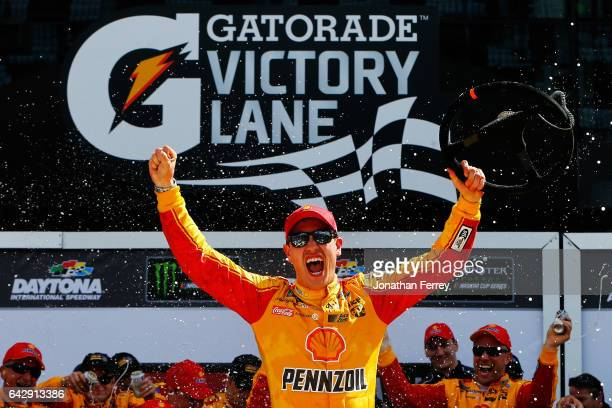 Joey Logano driver of the Shell Pennzoil Ford celebrates in victory lane after winning the weather delayed Monster Energy NASCAR Cup Series Advance...