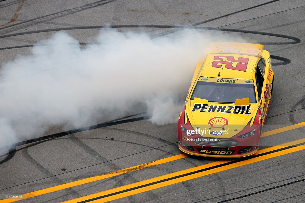 Joey Logano driver of the Shell Pennzoil Ford celebrates with a burnout after winning the NASCAR Sprint Cup Series CampingWorldcom 500 at Talladega...