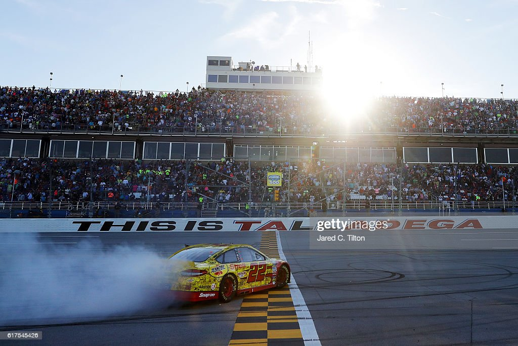 Joey Logano, driver of the #22 Shell Pennzoil Ford, celebrates with a burnout after winning the NASCAR Sprint Cup Series Hellmann's 500 at Talladega Superspeedway on October 23, 2016 in Talladega, Alabama.