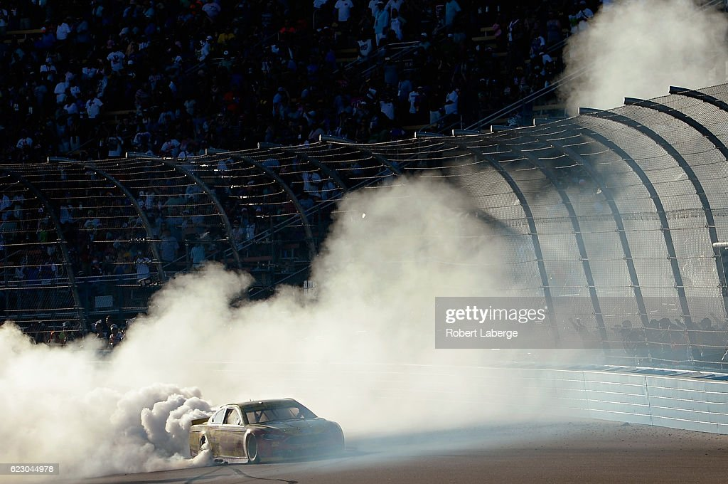Joey Logano, driver of the #22 Shell Pennzoil Ford, celebrates with a burnout after winning the NASCAR Sprint Cup Series Can-Am 500 at Phoenix International Raceway on November 13, 2016 in Avondale, Arizona.