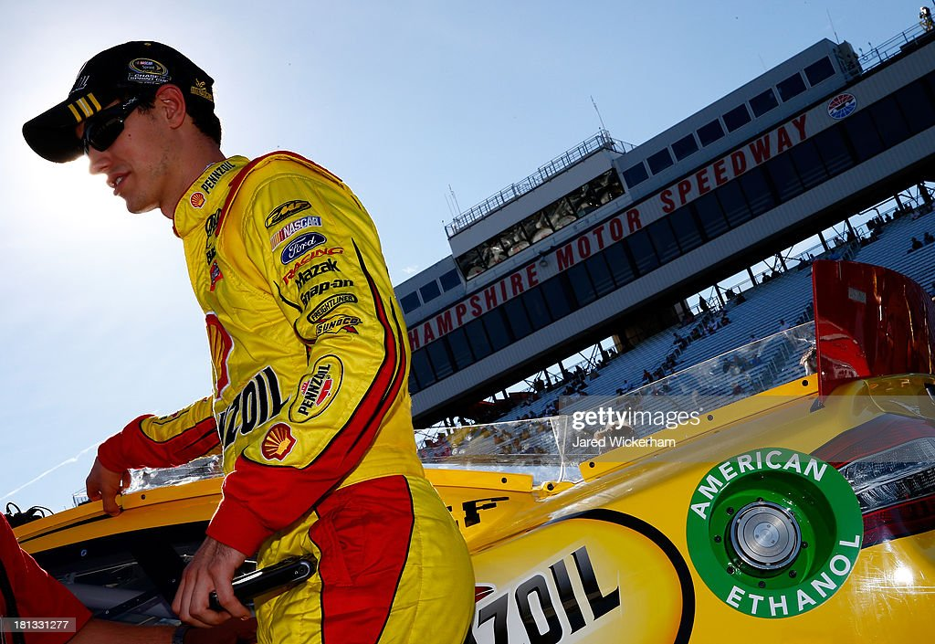 <a gi-track='captionPersonalityLinkClicked' href=/galleries/search?phrase=Joey+Logano&family=editorial&specificpeople=4510426 ng-click='$event.stopPropagation()'>Joey Logano</a>, driver of the #22 Shell Pennzoil Ford, climbs from his car after qualifying for the NASCAR Sprint Cup Series Sylvania 300 at New Hampshire Motor Speedway on September 20, 2013 in Loudon, New Hampshire.