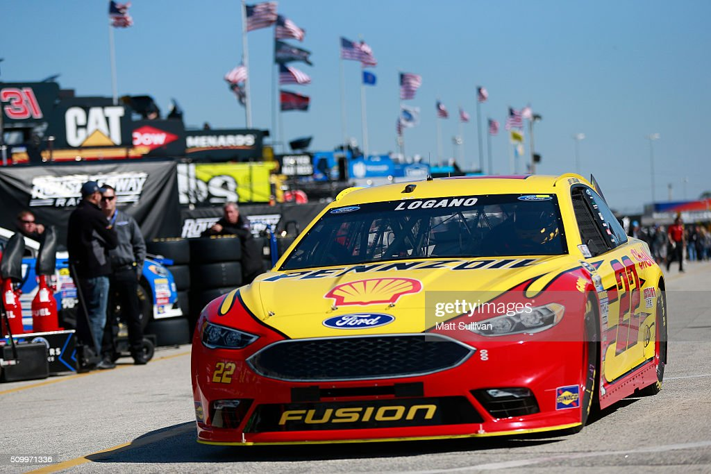 <a gi-track='captionPersonalityLinkClicked' href=/galleries/search?phrase=Joey+Logano&family=editorial&specificpeople=4510426 ng-click='$event.stopPropagation()'>Joey Logano</a>, driver of the #22 Shell Pennzoil Ford, drives through the garage area during practice for the NASCAR Sprint Cup Series Daytona 500 at Daytona International Speedway on February 13, 2016 in Daytona Beach, Florida.