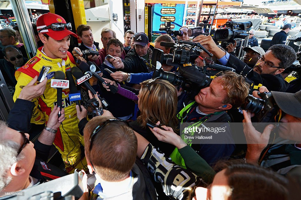 Joey Logano, driver of the #22 Shell Pennzoil Ford, is interviewed after practice for the NASCAR Sprint Cup Series STP Gas Booster 500 on April 5, 2013 at Martinsville Speedway in Ridgeway, Virginia.