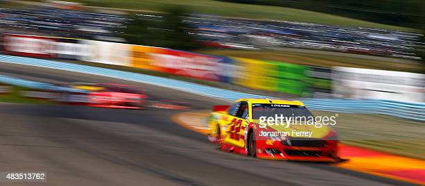 Joey Logano driver of the Shell Pennzoil Ford leads a pack of cars during the NASCAR Sprint Cup Series CheezIt 355 at the Glen at Watkins Glen...