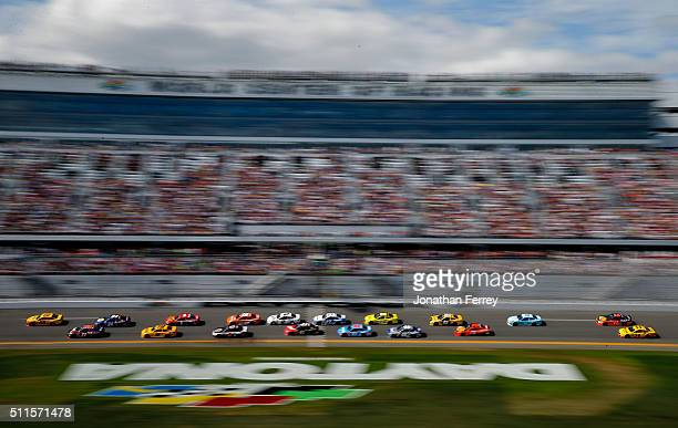 Joey Logano driver of the Shell Pennzoil Ford leads a pack of cars during the NASCAR Sprint Cup Series DAYTONA 500 at Daytona International Speedway...