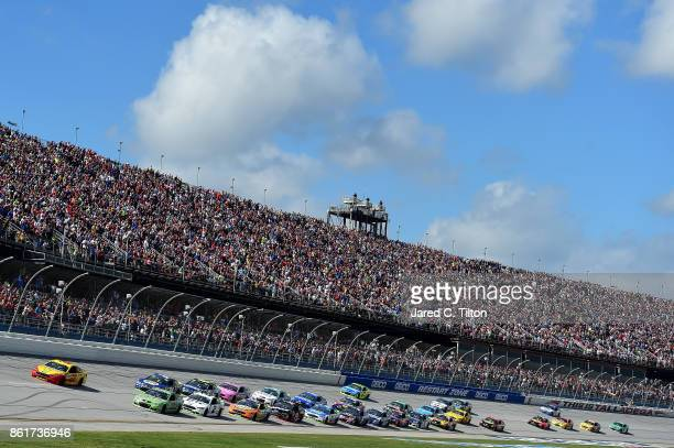 Joey Logano driver of the Shell Pennzoil Ford leads a pack of cars during the Monster Energy NASCAR Cup Series Alabama 500 at Talladega Superspeedway...