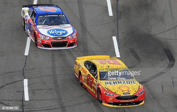 Joey Logano driver of the Shell Pennzoil Ford leads AJ Allmendinger driver of the Kroger/Clorox Chevrolet during the NASCAR Sprint Cup Series Goody's...