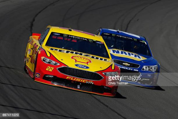 Joey Logano driver of the Shell Pennzoil Ford leads Chase Elliott driver of the NAPA Chevrolet during the Monster Energy NASCAR Cup Series...