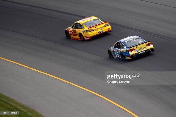 Joey Logano driver of the Shell Pennzoil Ford leads Chase Elliott driver of the NAPA Chevrolet during the Monster Energy NASCAR Cup Series Pure...