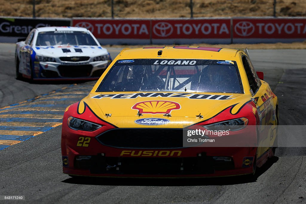 <a gi-track='captionPersonalityLinkClicked' href=/galleries/search?phrase=Joey+Logano&family=editorial&specificpeople=4510426 ng-click='$event.stopPropagation()'>Joey Logano</a>, driver of the #22 Shell Pennzoil Ford, leads <a gi-track='captionPersonalityLinkClicked' href=/galleries/search?phrase=Kevin+Harvick&family=editorial&specificpeople=209186 ng-click='$event.stopPropagation()'>Kevin Harvick</a>, driver of the #4 Mobil 1 Chevrolet, during the NASCAR Sprint Cup Series Toyota/Save Mart 350 at Sonoma Raceway on June 26, 2016 in Sonoma, California.