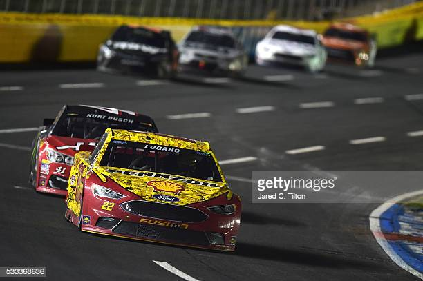 Joey Logano driver of the Shell Pennzoil Ford leads Kurt Busch driver of the Haas Automation/Monster Energy Chevrolet during the NASCAR Sprint Cup...