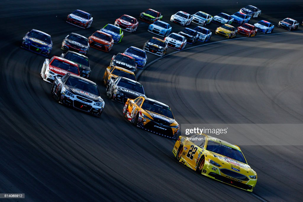 Joey Logano driver of the Shell Pennzoil Ford leads the field during the NASCAR Sprint Cup Series Kobalt 400 at Las Vegas Motor Speedway on March 6...