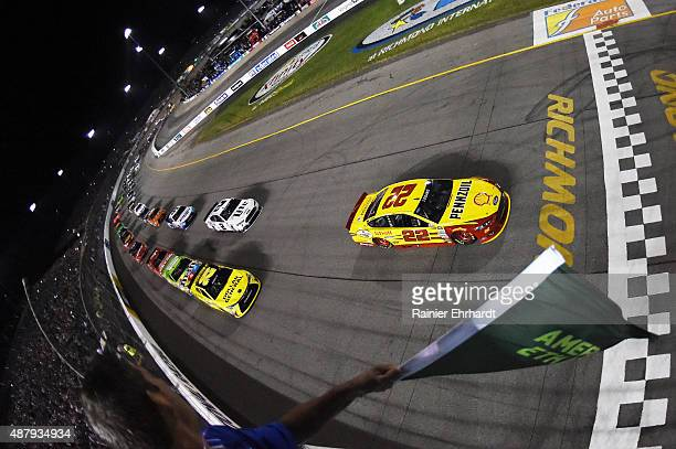 Joey Logano driver of the Shell Pennzoil Ford leads the field to the green flag to start the NASCAR Sprint Cup Series Federated Auto Parts 400 at...