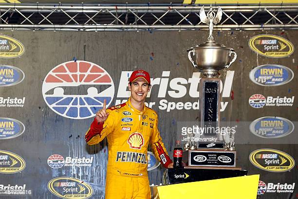 Joey Logano driver of the Shell Pennzoil Ford poses in victory lane after winning the NASCAR Sprint Cup Series IRWIN Tools Night Race at Bristol...