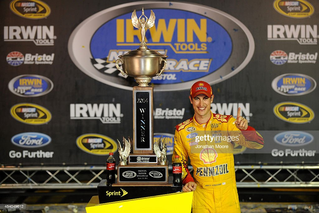 <a gi-track='captionPersonalityLinkClicked' href=/galleries/search?phrase=Joey+Logano&family=editorial&specificpeople=4510426 ng-click='$event.stopPropagation()'>Joey Logano</a>, driver of the #22 Shell Pennzoil Ford, poses with the trophy in Victory Lane after winning the NASCAR Sprint Cup Series Irwin Tools Night Race at Bristol Motor Speedway on August 23, 2014 in Bristol, Tennessee.