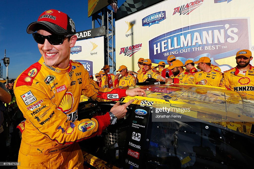 Joey Logano, driver of the #22 Shell Pennzoil Ford, poses with the winner's decal in Victory Lane after winning the NASCAR Sprint Cup Series Hellmann's 500 at Talladega Superspeedway on October 23, 2016 in Talladega, Alabama.