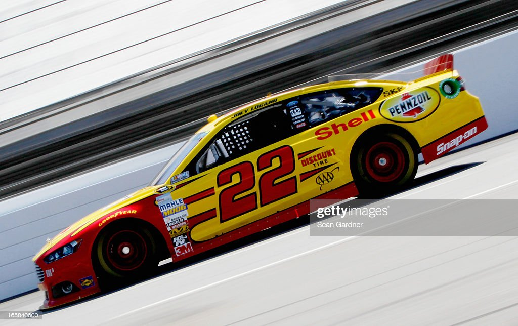 Joey Logano, driver of the #22 Shell Pennzoil Ford, practices for the NASCAR Sprint Cup Series STP Gas Booster 500 on April 6, 2013 at Martinsville Speedway in Ridgeway, Virginia.