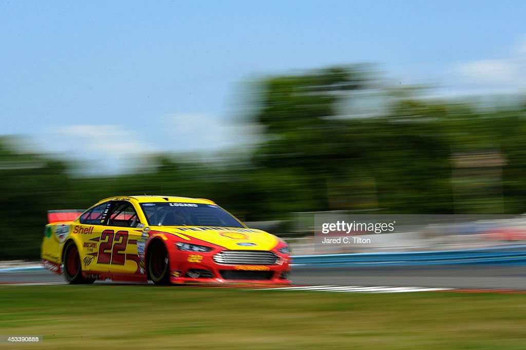 <a gi-track='captionPersonalityLinkClicked' href=/galleries/search?phrase=Joey+Logano&family=editorial&specificpeople=4510426 ng-click='$event.stopPropagation()'>Joey Logano</a>, driver of the #22 Shell Pennzoil Ford, qualifies for the NASCAR Sprint Cup Series Cheez-It 355 at Watkins Glen International on August 9, 2014 in Watkins Glen, New York.