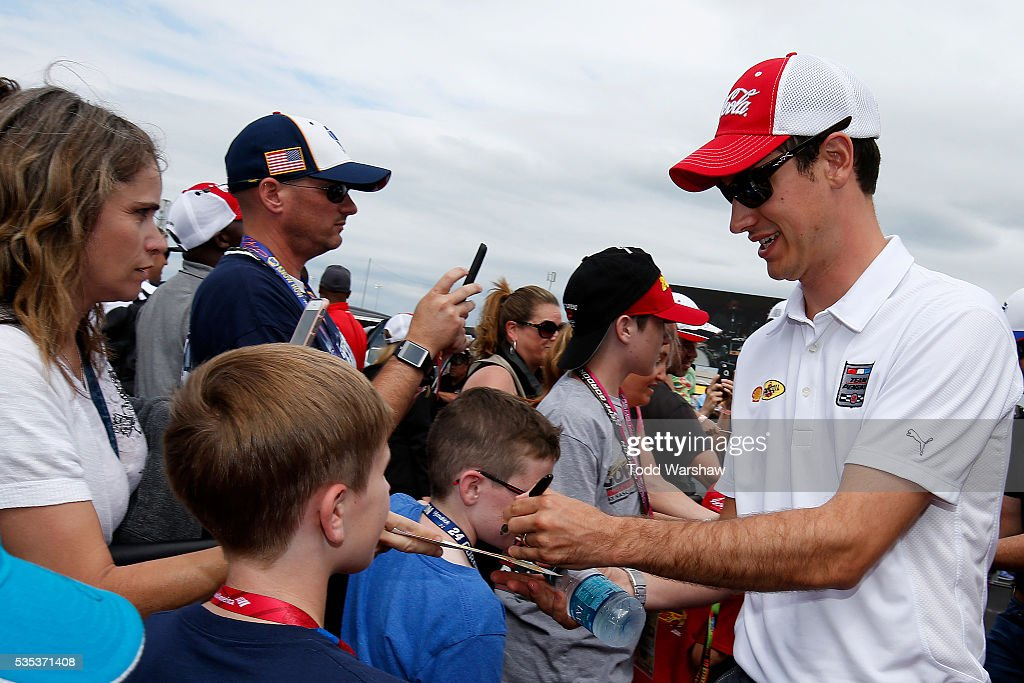 <a gi-track='captionPersonalityLinkClicked' href=/galleries/search?phrase=Joey+Logano&family=editorial&specificpeople=4510426 ng-click='$event.stopPropagation()'>Joey Logano</a>, driver of the #22 Shell Pennzoil Ford, signs autographs for fans at the driver's meeting prior to the NASCAR Sprint Cup Series Coca-Cola 600 at Charlotte Motor Speedway on May 29, 2016 in Charlotte, North Carolina.