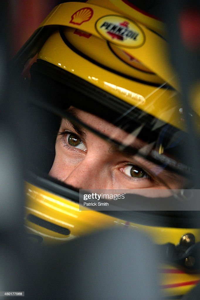Joey Logano, driver of the #22 Shell Pennzoil Ford, sits in his car during practice for the NASCAR Sprint Cup Series Pocono 400 at Pocono Raceway on June 6, 2014 in Long Pond, Pennsylvania.