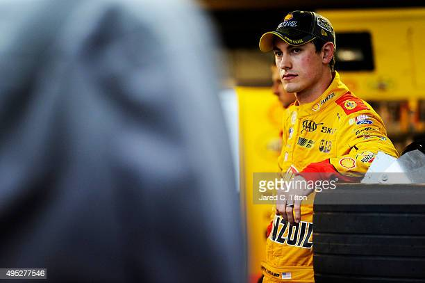 Joey Logano driver of the Shell Pennzoil Ford stands in the garage area after an on track incident with Matt Kenseth driver of the Dollar General...