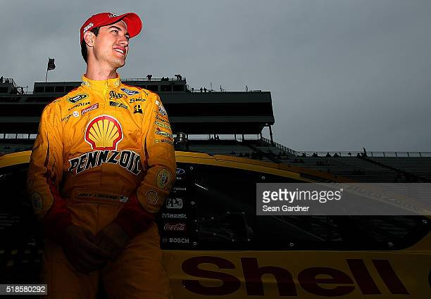 Joey Logano driver of the Shell Pennzoil Ford stands on the grid during qualifying for the NASCAR Sprint Cup Series STP 500 at Martinsville Speedway...