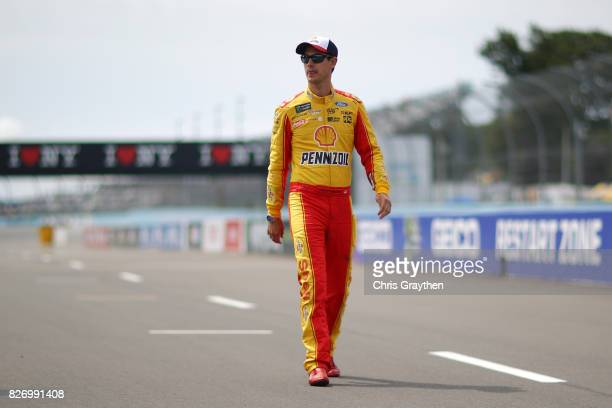 Joey Logano driver of the Shell Pennzoil Ford stands on the grid during qualifying for the Monster Energy NASCAR Cup Series I Love NY 355 at The Glen...