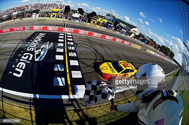 Joey Logano driver of the Shell Pennzoil Ford takes the checkered flag to win the NASCAR Sprint Cup Series CheezIt 355 at the Glen at Watkins Glen...