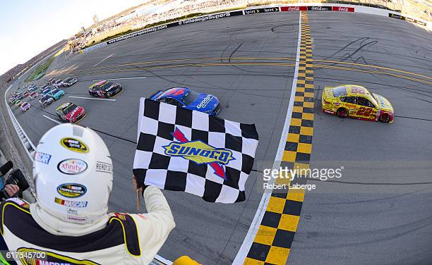 Joey Logano driver of the Shell Pennzoil Ford takes the checkered flag to win the NASCAR Sprint Cup Series Hellmann's 500 at Talladega Superspeedway...