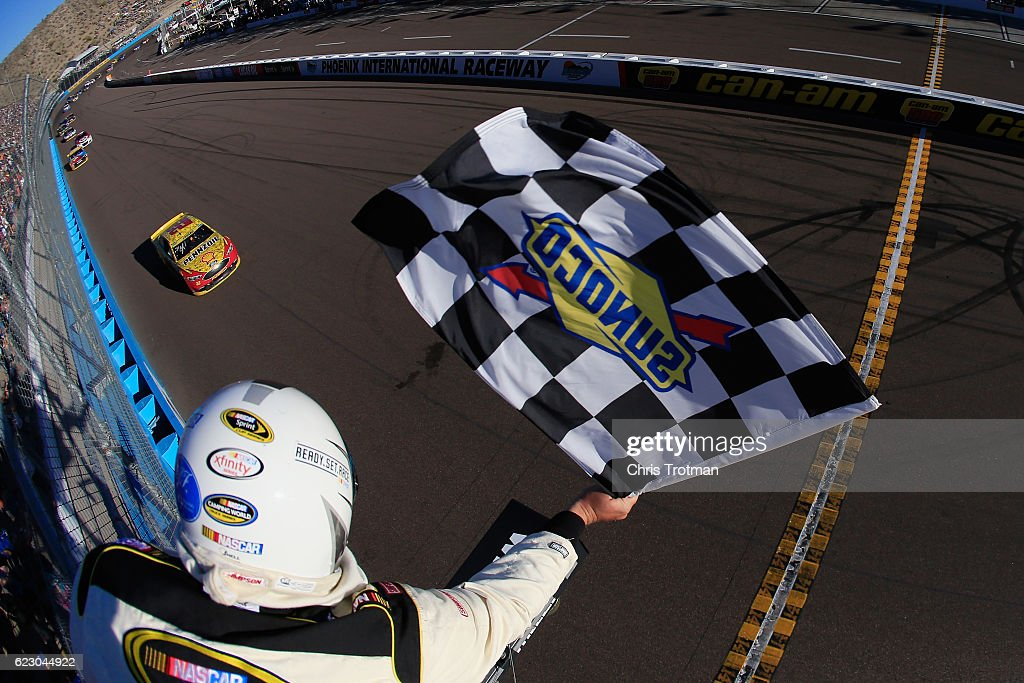 Joey Logano, driver of the #22 Shell Pennzoil Ford, takes the checkered flag to win the NASCAR Sprint Cup Series Can-Am 500 at Phoenix International Raceway on November 13, 2016 in Avondale, Arizona.