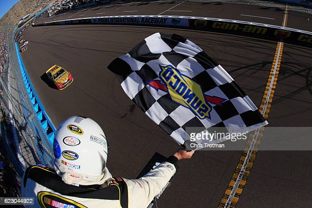 Joey Logano driver of the Shell Pennzoil Ford takes the checkered flag to win the NASCAR Sprint Cup Series CanAm 500 at Phoenix International Raceway...