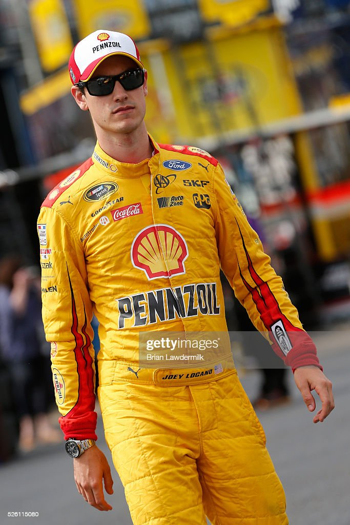 <a gi-track='captionPersonalityLinkClicked' href=/galleries/search?phrase=Joey+Logano&family=editorial&specificpeople=4510426 ng-click='$event.stopPropagation()'>Joey Logano</a>, driver of the #22 Shell Pennzoil Ford, walks through the garage area during practice for the NASCAR Sprint Cup Series GEICO 500 at Talladega Superspeedway on April 29, 2016 in Talladega, Alabama.