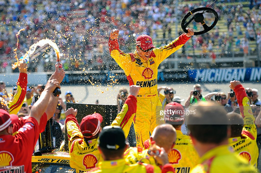 <a gi-track='captionPersonalityLinkClicked' href=/galleries/search?phrase=Joey+Logano&family=editorial&specificpeople=4510426 ng-click='$event.stopPropagation()'>Joey Logano</a>, driver of the #22 Shell-Pennzoil Ford, celebrates in Victory Lane after winning the NASCAR Sprint Cup Series 44th Annual Pure Michigan 400 at Michigan International Speedway on August 18, 2013 in Brooklyn, Michigan.