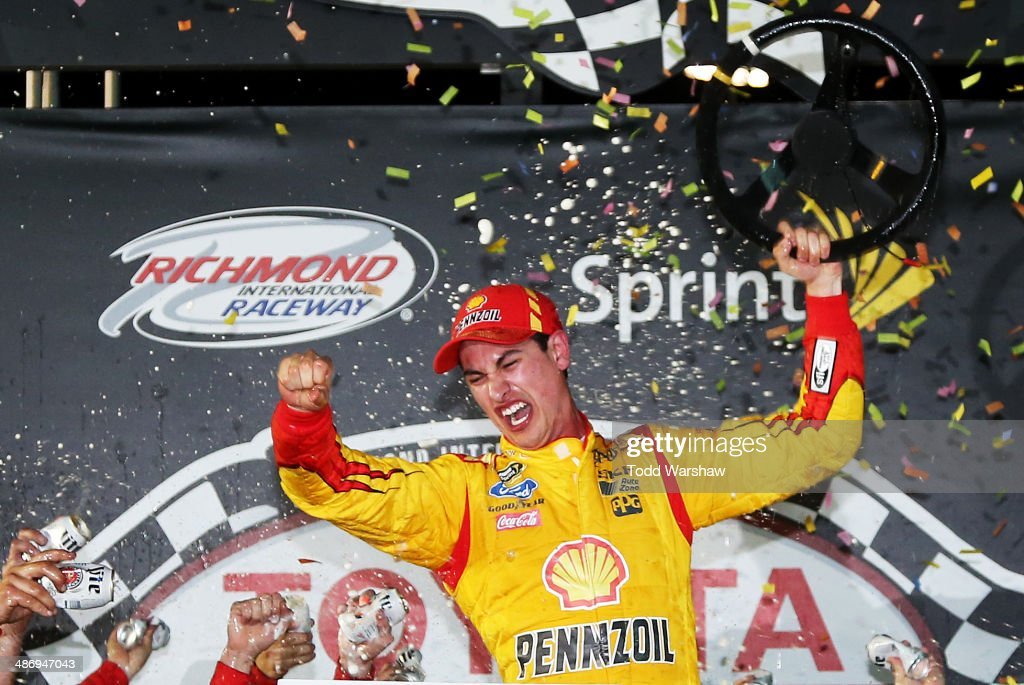 Joey Logano, driver of the #22 Shell-Pennzoil Ford, celebrates in Victory Lane after winning the NASCAR Sprint Cup Series Toyota Owners 400 at Richmond International Raceway on April 26, 2014 in Richmond, Virginia.