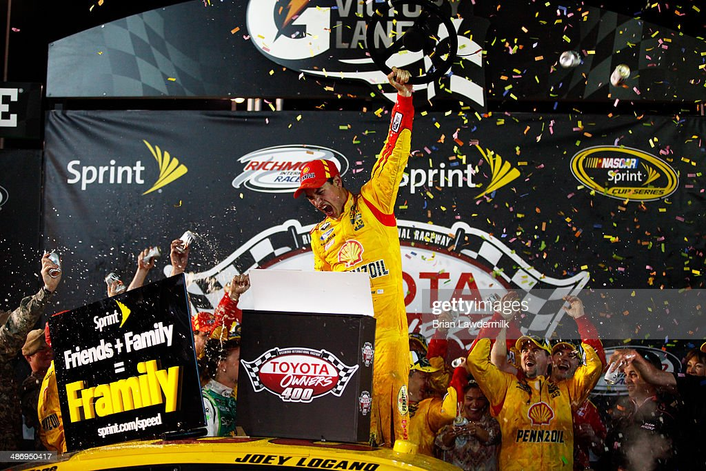 <a gi-track='captionPersonalityLinkClicked' href=/galleries/search?phrase=Joey+Logano&family=editorial&specificpeople=4510426 ng-click='$event.stopPropagation()'>Joey Logano</a>, driver of the #22 Shell-Pennzoil Ford, celebrates in Victory Lane after winning the NASCAR Sprint Cup Series Toyota Owners 400 at Richmond International Raceway on April 26, 2014 in Richmond, Virginia.