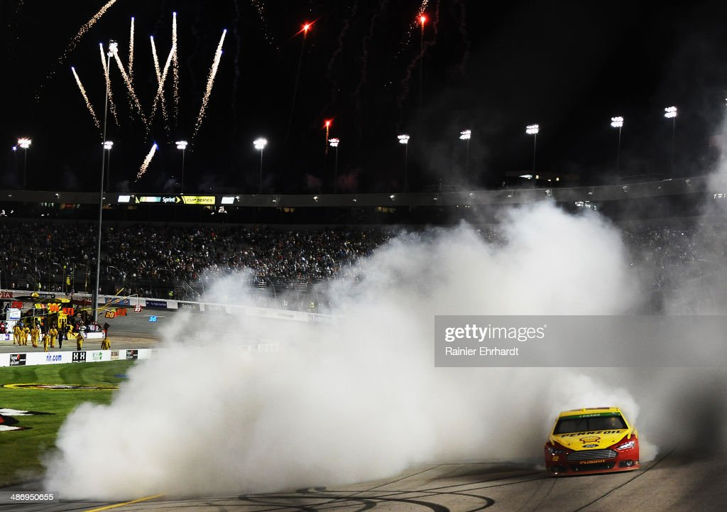 <a gi-track='captionPersonalityLinkClicked' href=/galleries/search?phrase=Joey+Logano&family=editorial&specificpeople=4510426 ng-click='$event.stopPropagation()'>Joey Logano</a>, driver of the #22 Shell-Pennzoil Ford, celebrates with a burnout after winning the NASCAR Sprint Cup Series Toyota Owners 400 at Richmond International Raceway on April 26, 2014 in Richmond, Virginia.