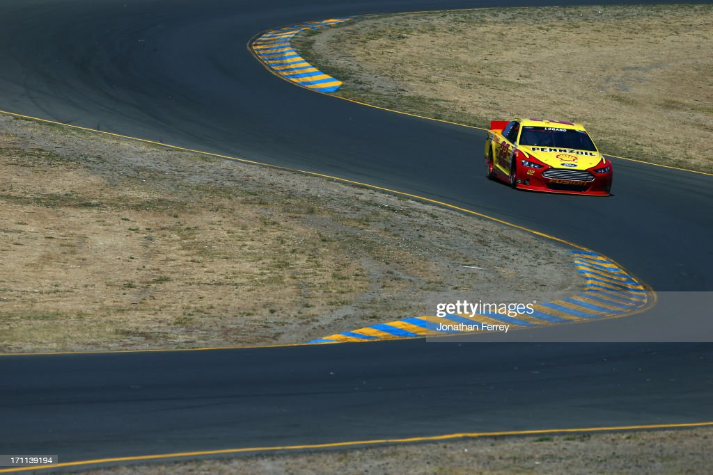 <a gi-track='captionPersonalityLinkClicked' href=/galleries/search?phrase=Joey+Logano&family=editorial&specificpeople=4510426 ng-click='$event.stopPropagation()'>Joey Logano</a>, driver of the #22 Shell-Pennzoil Ford, drives during qualifying for the NASCAR Sprint Cup Series Toyota/Save Mart 350 at Sonoma Raceway on June 22, 2013 in Sonoma, California.