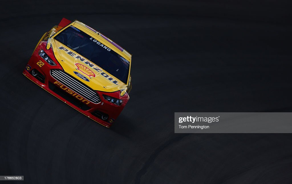 <a gi-track='captionPersonalityLinkClicked' href=/galleries/search?phrase=Joey+Logano&family=editorial&specificpeople=4510426 ng-click='$event.stopPropagation()'>Joey Logano</a>, driver of the #22 Shell-Pennzoil Ford, during practices for the NASCAR Sprint Cup Series 44th Annual Pure Michigan 400 at Michigan International Speedway on August 16, 2013 in Brooklyn, Michigan.