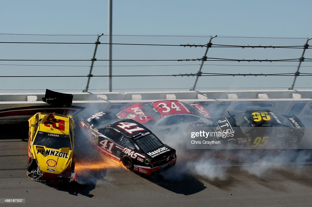 <a gi-track='captionPersonalityLinkClicked' href=/galleries/search?phrase=Joey+Logano&family=editorial&specificpeople=4510426 ng-click='$event.stopPropagation()'>Joey Logano</a>, driver of the #22 Shell-Pennzoil Ford, <a gi-track='captionPersonalityLinkClicked' href=/galleries/search?phrase=Kurt+Busch&family=editorial&specificpeople=201728 ng-click='$event.stopPropagation()'>Kurt Busch</a>, driver of the #41 Haas Automation Chevrolet, <a gi-track='captionPersonalityLinkClicked' href=/galleries/search?phrase=David+Ragan&family=editorial&specificpeople=574874 ng-click='$event.stopPropagation()'>David Ragan</a>, driver of the #34 KFC Go Cup Ford, and <a gi-track='captionPersonalityLinkClicked' href=/galleries/search?phrase=Michael+McDowell+-+Race+Car+Driver&family=editorial&specificpeople=12880477 ng-click='$event.stopPropagation()'>Michael McDowell</a>, driver of the #95 Jordan Truck Sales Ford, crash during the NASCAR Sprint Cup Series Aaron's 499 at Talladega Superspeedway on May 4, 2014 in Talladega, Alabama.