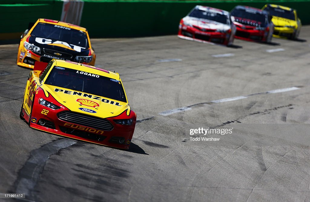 <a gi-track='captionPersonalityLinkClicked' href=/galleries/search?phrase=Joey+Logano&family=editorial&specificpeople=4510426 ng-click='$event.stopPropagation()'>Joey Logano</a>, driver of the #22 Shell-Pennzoil Ford, leads a group of cars during the NASCAR Sprint Cup Series Quaker State 400 at Kentucky Speedway on June 30, 2013 in Sparta, Kentucky.