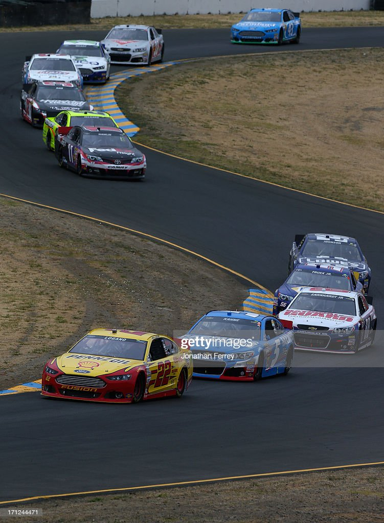 Joey Logano, driver of the #22 Shell-Pennzoil Ford, leads a pack of cars during the NASCAR Sprint Cup Series Toyota/Save Mart 350 at Sonoma Raceway on June 23, 2013 in Sonoma, California.