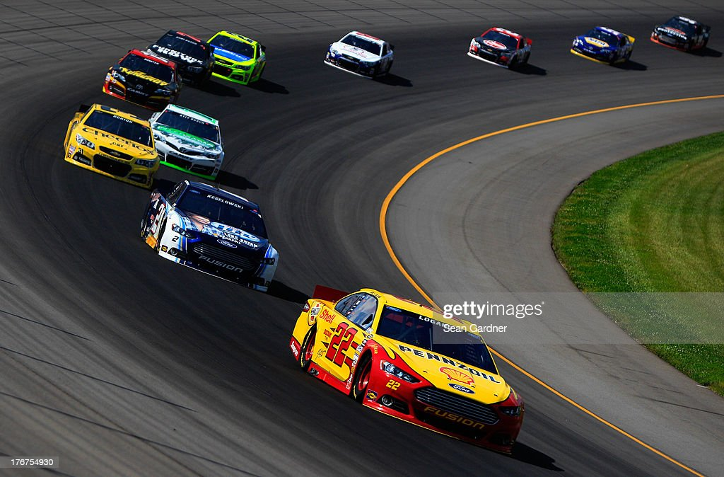 <a gi-track='captionPersonalityLinkClicked' href=/galleries/search?phrase=Joey+Logano&family=editorial&specificpeople=4510426 ng-click='$event.stopPropagation()'>Joey Logano</a>, driver of the #22 Shell-Pennzoil Ford, leads a pack of cars during the NASCAR Sprint Cup Series 44th Annual Pure Michigan 400 at Michigan International Speedway on August 18, 2013 in Brooklyn, Michigan.