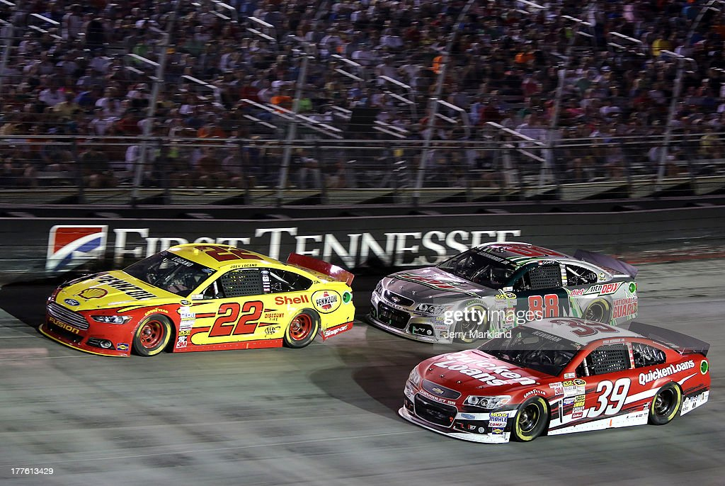 Joey Logano, driver of the #22 Shell-Pennzoil Ford, leads Dale Earnhardt Jr., driver of the #88 Diet Mountain Dew Chevrolet, and Ryan Newman, driver of the #39 Quicken Loans Chevrolet, during the NASCAR Sprint Cup Series 53rd Annual IRWIN Tools Night Race at Bristol Motor Speedway on August 24, 2013 in Bristol, Tennessee.