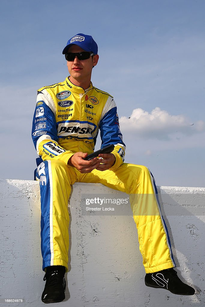 <a gi-track='captionPersonalityLinkClicked' href=/galleries/search?phrase=Joey+Logano&family=editorial&specificpeople=4510426 ng-click='$event.stopPropagation()'>Joey Logano</a>, driver of the #22 Shell-Pennzoil Ford, looks on during qualifying for the NASCAR Sprint Cup Series Bojangles' Southern 500 at Darlington Raceway on May 10, 2013 in Darlington, South Carolina.