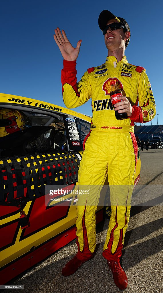 <a gi-track='captionPersonalityLinkClicked' href=/galleries/search?phrase=Joey+Logano&family=editorial&specificpeople=4510426 ng-click='$event.stopPropagation()'>Joey Logano</a>, driver of the #22 Shell-Pennzoil Ford, looks on during qualifying for the NASCAR Sprint Cup Series Geico 400 at Chicagoland Speedway on September 13, 2013 in Joliet, Illinois.