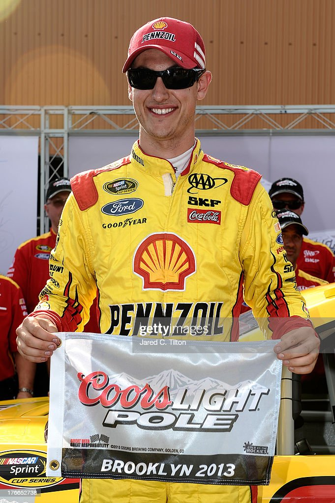 <a gi-track='captionPersonalityLinkClicked' href=/galleries/search?phrase=Joey+Logano&family=editorial&specificpeople=4510426 ng-click='$event.stopPropagation()'>Joey Logano</a>, driver of the #22 Shell-Pennzoil Ford, poses with the Coors Light Pole Award after qualifying for pole position for the NASCAR Sprint Cup Series 44th Annual Pure Michigan 400 at Michigan International Speedway on August 16, 2013 in Brooklyn, Michigan.