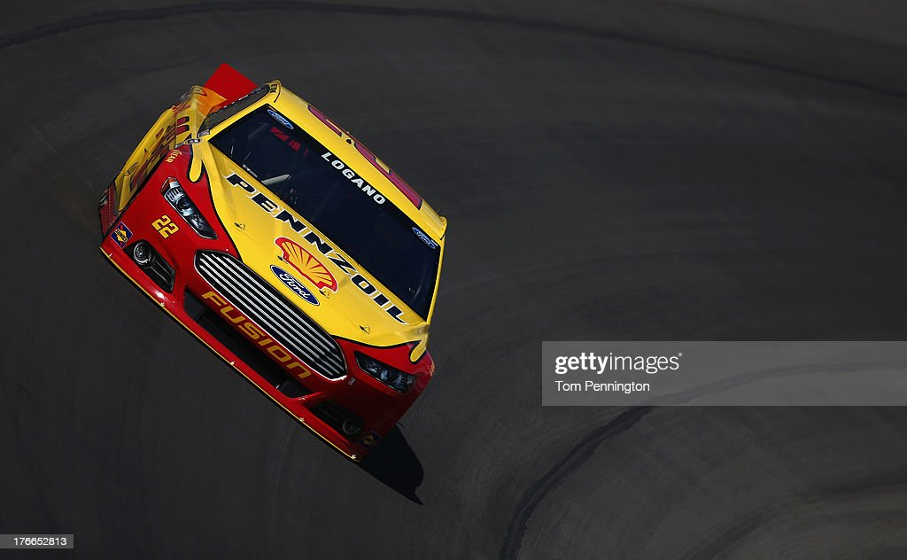 Joey Logano, driver of the #22 Shell-Pennzoil Ford, practices for the NASCAR Sprint Cup Series 44th Annual Pure Michigan 400 at Michigan International Speedway on August 16, 2013 in Brooklyn, Michigan.