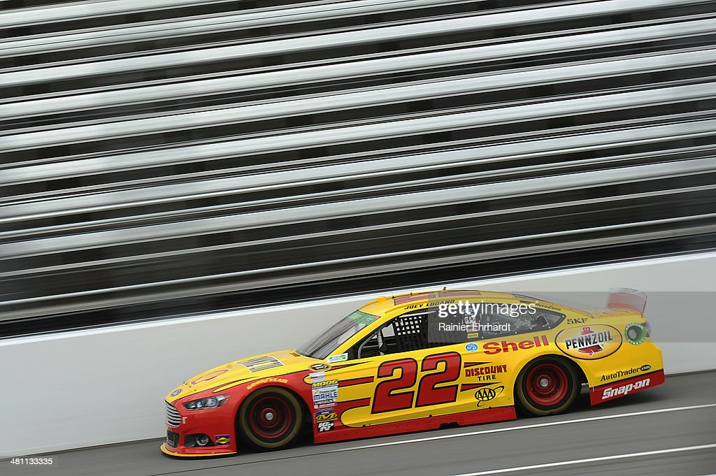 Joey Logano, driver of the #22 Shell-Pennzoil Ford, practices for the NASCAR Sprint Cup Series STP 500 at Martinsville Speedway on March 28, 2014 in Martinsville, Virginia.