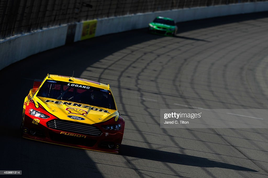 Joey Logano, driver of the #22 Shell-Pennzoil Ford, qualifies for the NASCAR Sprint Cup Series Pure Michigan 400 at Michigan International Speedway on August 15, 2014 in Brooklyn, Michigan.